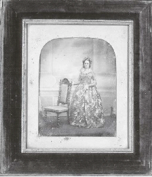 Woman standing with chair
