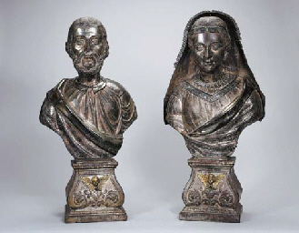 A PAIR OF SILVERED AND PARCEL-