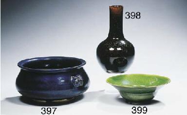 A green-glazed ogee bowl