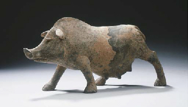 A grey pottery figure of a pig