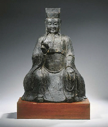 A bronze figure of a dignitary