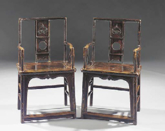 A pair of lacquered armchairs