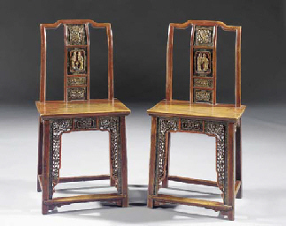 A pair of lacquered yokeback c