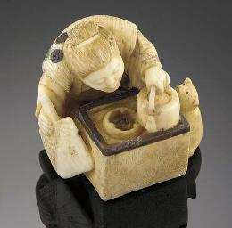 An ivory netsuke of an old wom