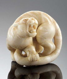 An ivory netsuke of a tiger Ci