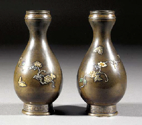 A pair of inlaid bronze bottle