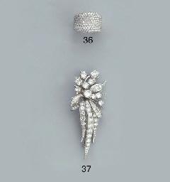 AN 18K WHITE GOLD DIAMOND BAND