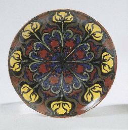 A glazed pottery wall plate