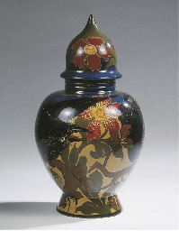 A glazed pottery vase and cove