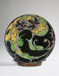 A large glazed pottery wall-pl