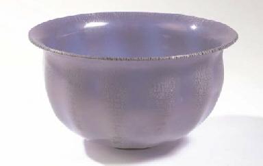 An Unica blue glass bowl