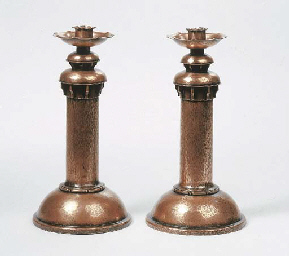 A pair of hammered copper cand