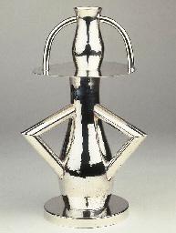Alaska, a hammered silver vase