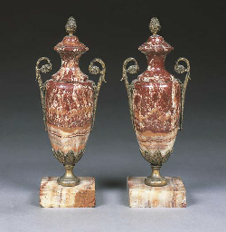 A pair of onyx and gilt metal
