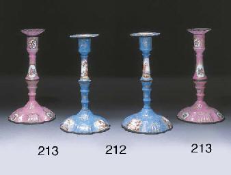 A pair of enamel candlesticks
