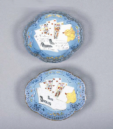 Two similar enamel dishes