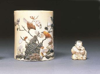 A Japanese cylindrical ivory e