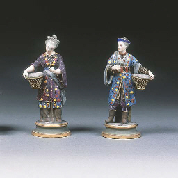 A pair of French porcelain swe