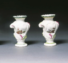 A pair of Derby rococo scroll-