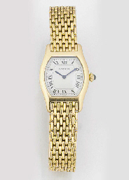 CARTIER, A LADY'S 18ct. GOLD TONNEAU SHAPED WRISTWATCH signed Cartier circa...