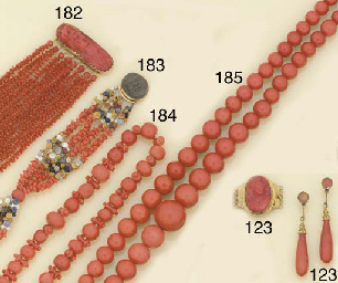An antique coral bead and carv