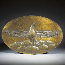A PATINATED OVAL BRONZE PLAQUE