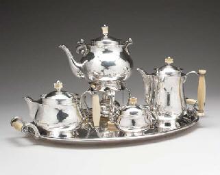 A FOUR PIECE GERMAN SILVER TEA