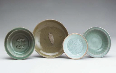 A GROUP OF FOUR CELADON AND QI