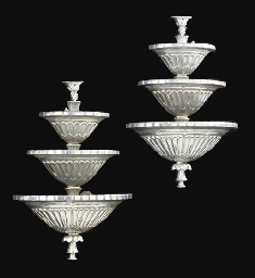A PAIR OF SILVERED-METAL THREE