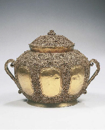 a sumatra gold bowl and cover