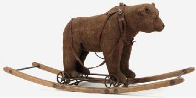 A rare Steiff bear on wheel