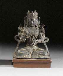 A laqcuered bronze figure of a