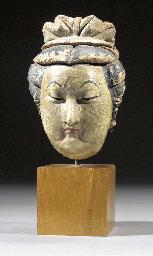 A stucco head of a lady Ming D