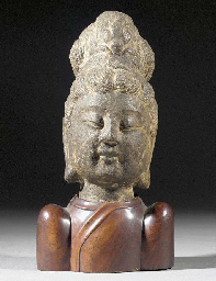 A stone head of Guanyin Yuan/E