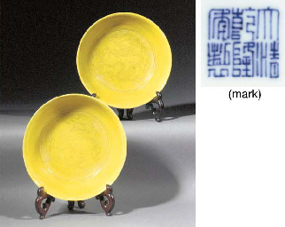 A pair of yellow glazed saucer