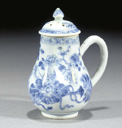 A blue and white pepper pot an