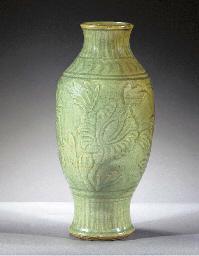 A celadon glazed slender balus