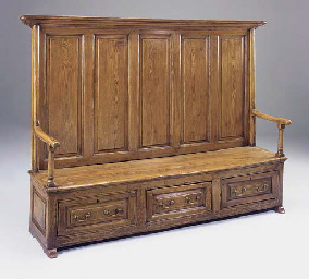 A large pine highback settle,