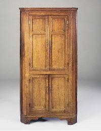An oak free standing corner cupboard, possibly Welsh, mid 19th century
