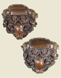A pair of German carved boxwood wall brackets, early 19th century