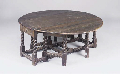 A large oak gateleg dining tab