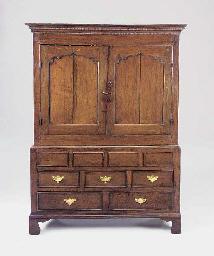 An oak press cupboard, Welsh,