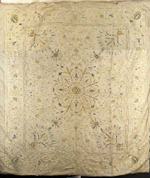 An embroidered cover of ivory