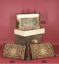 A pair of strapwork cushions,