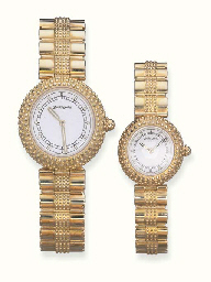 A SET OF 18K GOLD WRISTWATCHES
