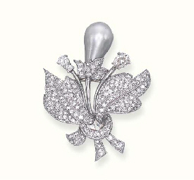 A PEARL AND DIAMOND FLOWER CLI