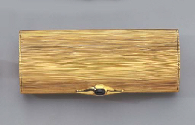 An 18k GOLD CIGARETTE CASE AND