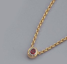 A GEM SET RING AND A RUBY NECK