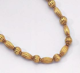 ZOLOTAS. A GOLD BEAD NECKLACE