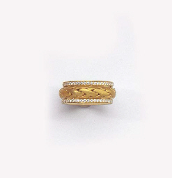 A GOLD AND DIAMOND BAND RING